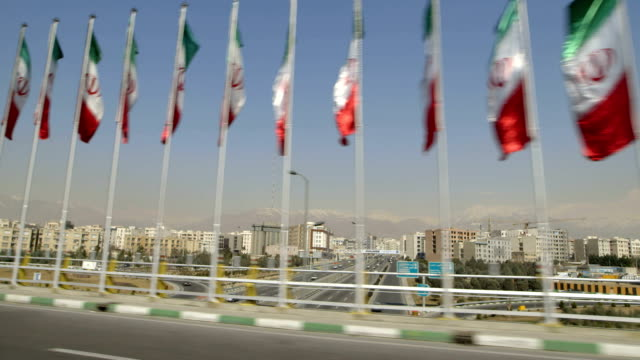 the flag of iran waving in tehran - teheran video stock e b–roll
