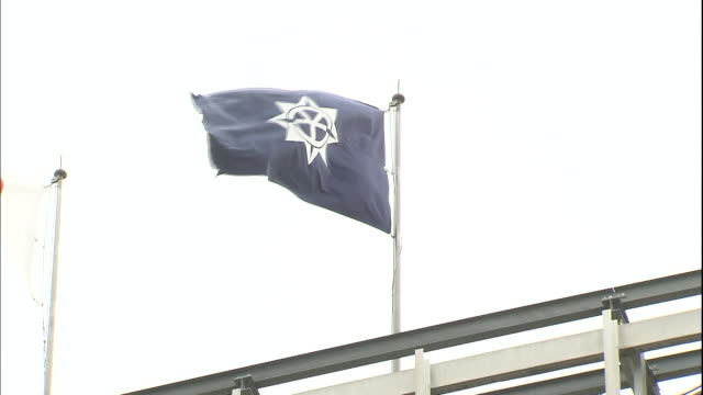 the flag of okayama flutters over the okayama city government office in japan. - japan flag stock videos & royalty-free footage