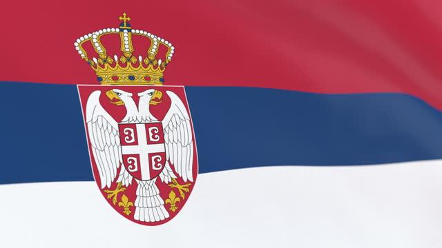 vídeos de stock, filmes e b-roll de a bandeira do laço sérvio - sérvia