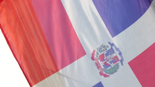 the flag of the dominican republic waving - frayed stock videos & royalty-free footage