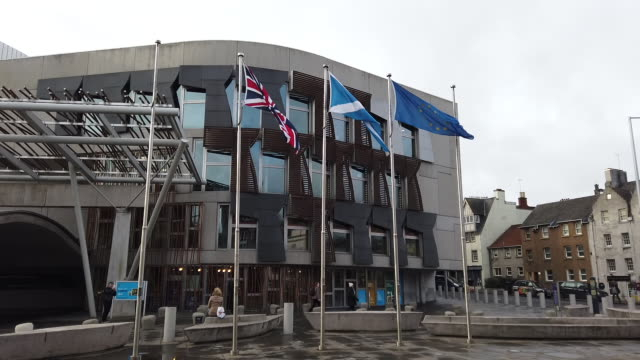 the flag of the european union flies outside the scottish parliament as msps debate whether it should still be flown after the uk's exit from the eu,... - scottish flag stock videos & royalty-free footage