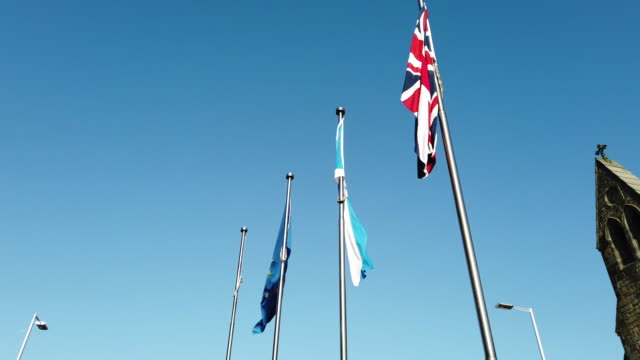 the flag of the european union, the scottish saltire, and the union flag, fly outside the scottish parliament, on october 8, 2019 in edinburgh,... - scottish flag stock videos & royalty-free footage