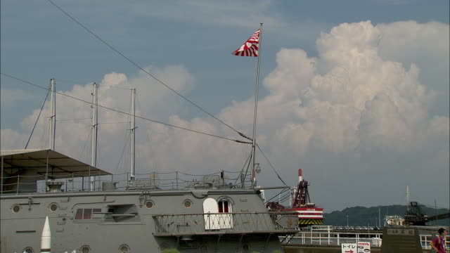 the flag of the imperial japanese navy, flies from the stern of the battleship mikasa in yokosuka.  - battleship stock videos & royalty-free footage