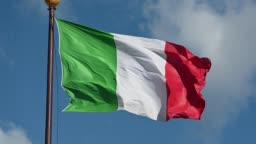The flag of the Italian Republic flies in the large square of Palmanova