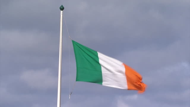 The flag of the Republic of Ireland is lowered to the sound of a marching band drummer to mark the centenary of the Easter Rising