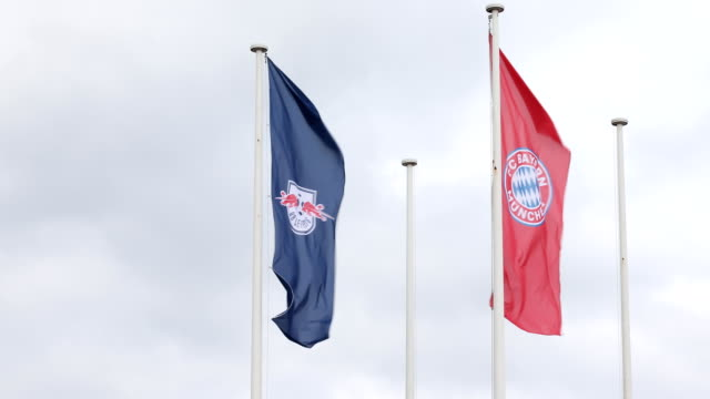 The flags of FC Bayern Munich and RB Leipzig in front of the stadium ahead of the DFB Cup Final 2019 between RB Leipzig and Bayern Muenchen at...