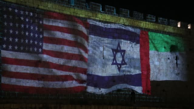 stockvideo's en b-roll-footage met the flags of the united states, israel, the uae, and bahrain were projected on the walls of the old city on september 16, 2020 after israel signed... - perzische golf