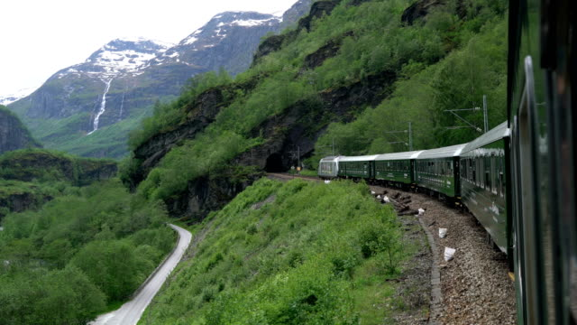 the flam line (norwegian: flamsbana) is a branch line of the bergen line which runs between myrdal and flam in aurland, norway. because of the line's steep incline and scenery, it is a major tourist attraction. - rail transportation stock videos & royalty-free footage