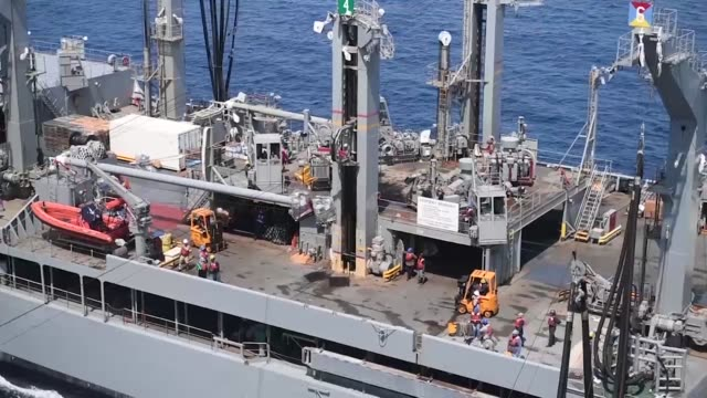 the fleet replenishment oiler usns guadalupe refuels the aircraft carrier uss theodore roosevelt during a fuelingatsea theodore roosevelt is deployed... - henry j. kaiser stock videos and b-roll footage