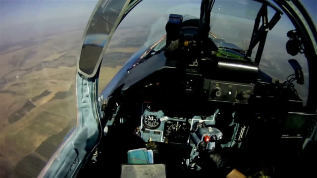 The flight of a military aircraft. View from the cockpit.