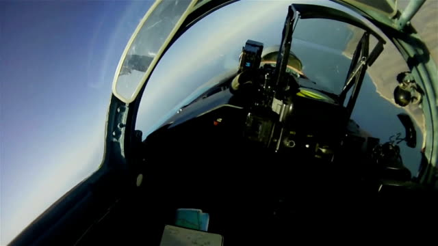 the flight of a military aircraft. view from the cockpit. - pilot stock videos and b-roll footage