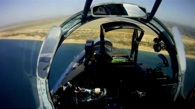 the flight of a military aircraft. view from the cockpit. - piloting stock videos and b-roll footage