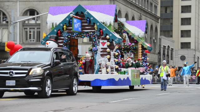 the float of canadian tire in the corner of bloor street and queens park. the event is a tradition held in the canadian city for more than a hundred... - parade stock videos & royalty-free footage