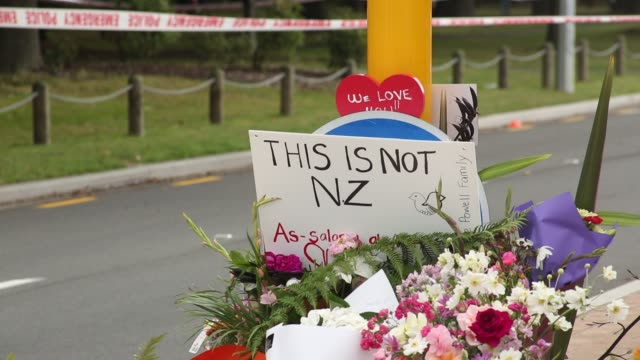 the floral tributes grow near the al noor mosque on deans rd on march 16 2019 in christchurch new zealand at least 49 people are confirmed dead with... - christchurch stock-videos und b-roll-filmmaterial