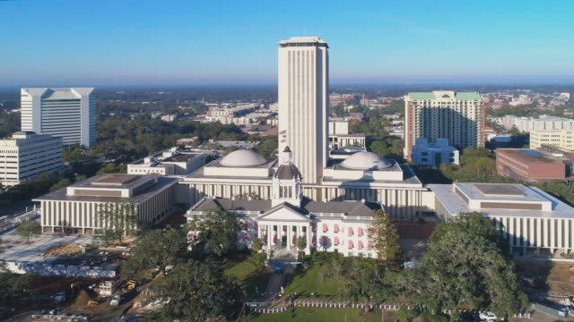 the florida state capitol, tallahassee.  aerial drone video with the cinematic wide-orbit panoramic camera motion. - capital cities stock videos & royalty-free footage
