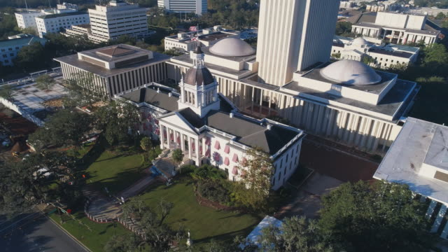 the florida state capitol, tallahassee.  aerial drone video with the cinematic orbit and tilting-up camera motion. - capital cities stock videos & royalty-free footage