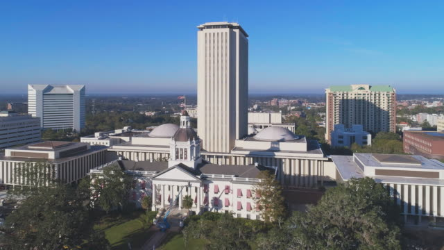 the florida state capitol, tallahassee.  aerial drone video with the cinematic wide-orbit panoramic camera motion. - florida us state stock videos and b-roll footage