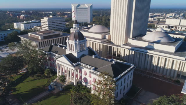 the florida state capitol, tallahassee.  aerial drone video with the cinematic complex ascending and tilting-down camera motion. - florida us state stock videos & royalty-free footage