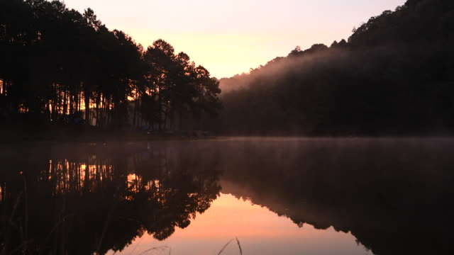 the fog faded. the water surface in the morning at pang ung a large reservoir on the top of the hill, a popular tourist destination in mae hong son. - mae hong son province stock videos and b-roll footage
