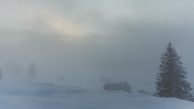 t/l of the fog rolling in on a snowy hill in kruen - garmisch partenkirchen stock videos and b-roll footage