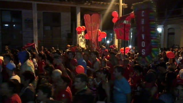The followers of 'La Loma' district collectively dancing to the tune of a 'conga' music Parrandas are a traditional carnivallike street party with...