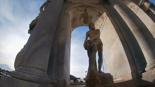 the fontana dei giganti on the waterfront of naples - fountain stock videos & royalty-free footage