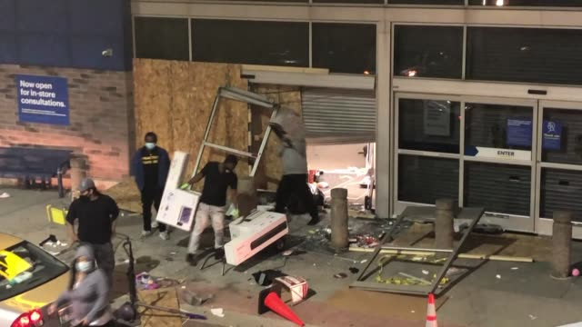 the footage shows protestors looting a shop in chicago on may 31, 2020. while the protests started over the murder of george floyd continues,... - looting stock videos & royalty-free footage