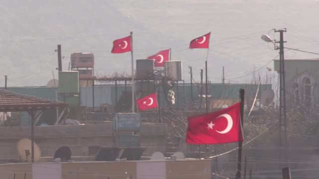 The footage shows that Turkish flags are displayed on a building as Turkish Army's armoured vehicles deployed as reinforcement to troops at the...