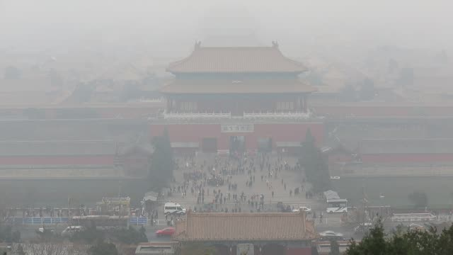 the forbidden city is covered by heavy smog on nov 29 2014 - beijing stock videos & royalty-free footage