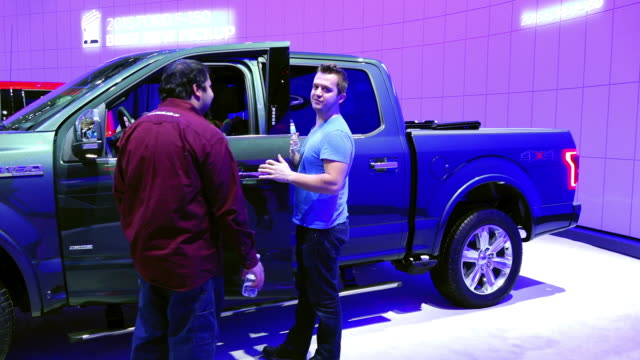 the ford f150 display in the floor of the toronto metro convention centre the vehicle has been named 'truck of the year' the transportation event is... - transportation event stock videos and b-roll footage
