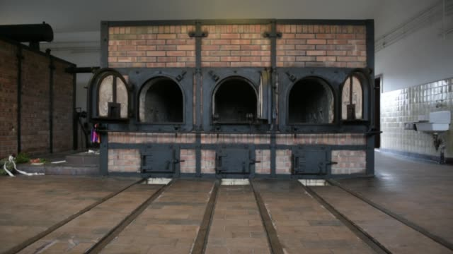 the former crematorium stands at the buchenwald concentration camp on january 26, 2018 near weimar, germany. tomorrow, january 27, is international... - weimar video stock e b–roll