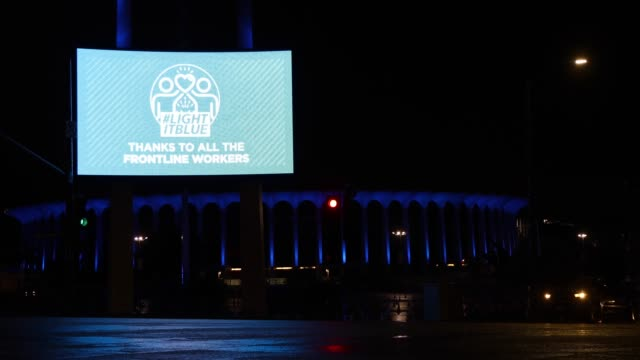 USA: Across U.S., Stadiums, Landmarks Illuminated In Blue To Honor Essential Workers