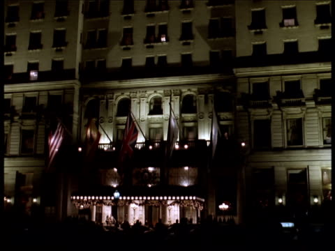 the fountain in front of the plaza hotel is ringed with lit christmas trees at christmas time. - 1 minute or greater stock videos & royalty-free footage