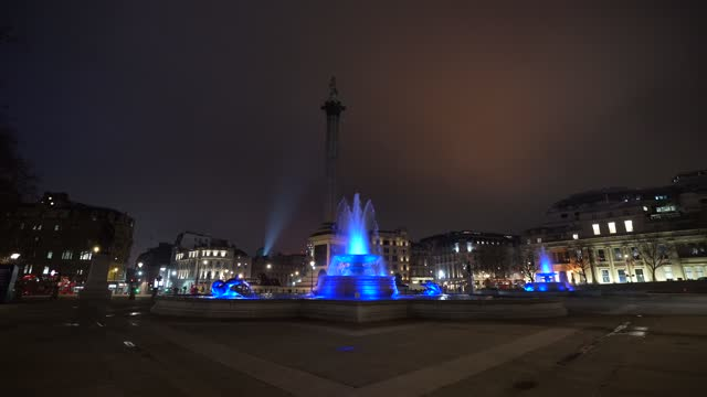 the fountains at trafalgar square lit up in blue to support the nhs during the coronavirus pandemic on january 7, 2021 in london, england. in a... - blue stock videos & royalty-free footage