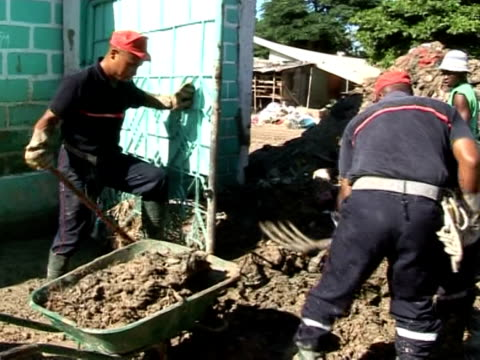 vídeos de stock e filmes b-roll de the four major storms that struck haiti recently have left at least 326 people dead and 50 missing. a french team of firemen is now helping haitians... - hispaniola