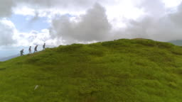 The four people walking up the mountain
