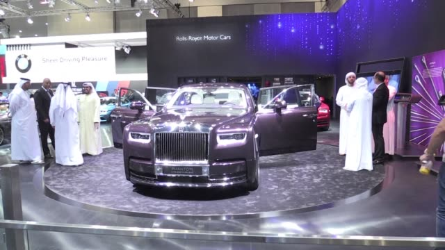 the fourteenth edition of the dubai international motor show opened on tuesday with visitors attending to see the latest releases from major... - circa 14th century stock videos & royalty-free footage