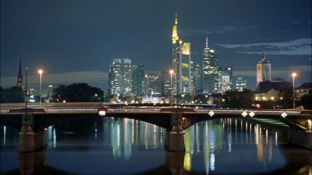 The Frankfurt skyline reflects into the Main River.