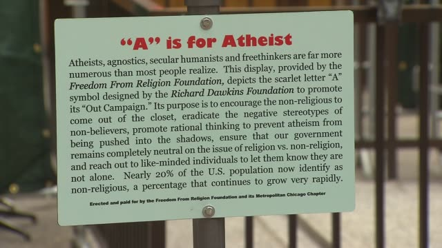 """the freedom from religion foundation erected a 8 foot tall a representing atheists and agnostics in the holiday display at daley plaza. """"a"""" is for... - atheism stock videos & royalty-free footage"""