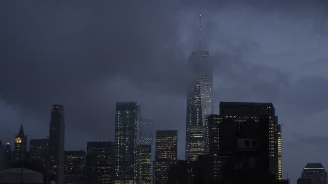 the freedom tower in fog at dusk - one world trade center stock videos & royalty-free footage