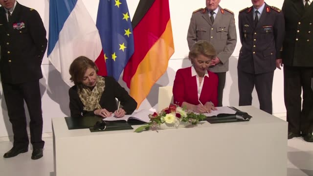 the french army minister florence parly and her german counterpart ursula von der leyen sign an agreement to launch the future franco german fighter... - esercito militare francese video stock e b–roll