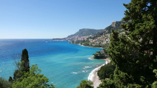the french coast. beach. monaco in the background - monaco stock videos & royalty-free footage