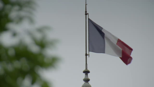 the french tricolore flag flies from a flagpole on troyes' town hall, france. - flag blowing in the wind stock videos & royalty-free footage