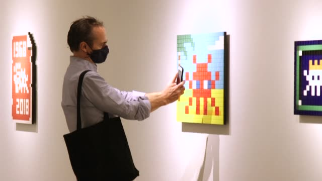 the french urban artist invader, whose visual style draws inspiration from vintage video games, has opened a solo exhibition of new works at a hong... - artist stock videos & royalty-free footage