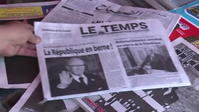 the front pages of french and arabic newspapers in tunisia headlining with the death of tunisian president beji caid essebsi as residents of tunis... - tunisia stock videos & royalty-free footage