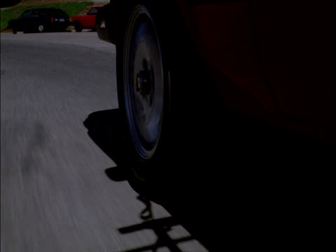 The front wheel on the driver's side blows out and comes to a stop.