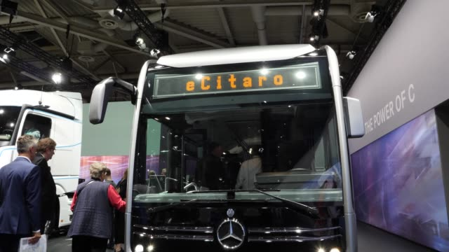 the fully electronically driven ecitaro bus stands among vehicles on display at the annual daimler ag shareholders meeting on may 22, 2019 in berlin,... - annual general meeting stock videos & royalty-free footage