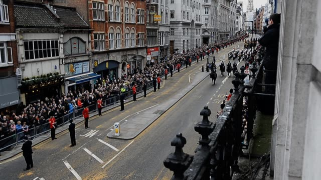 The funeral cortege carrying the body of former British Prime Minister Margaret Thatcher passes along Fleet Street on April 17 2013 in London England...