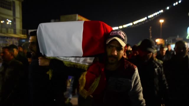 the funeral of a lynched teenager hanged by a crowd in baghdad on thursday takes place in the holy shrine city of najaf - najaf stock videos & royalty-free footage