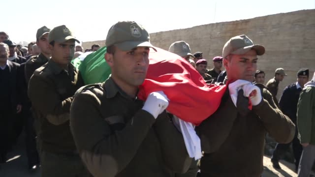 vídeos de stock, filmes e b-roll de the funeral of palestinian ambassador jamal aljamal who was killed by an exploding safe in his residence in prague was held on wednesday in ramallah... - ramallah